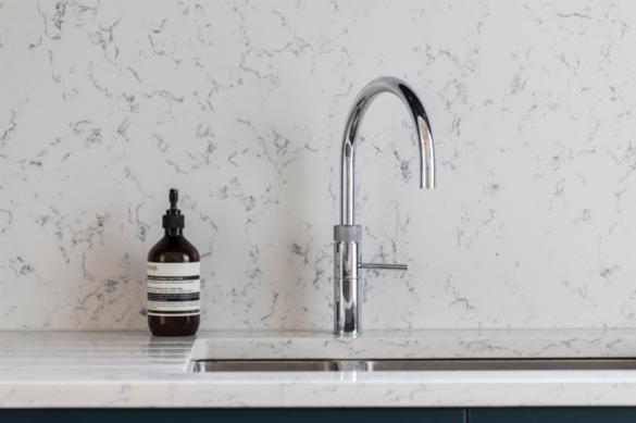A Stoneham stainless steel sinks enveloped in Silestone Quartz.