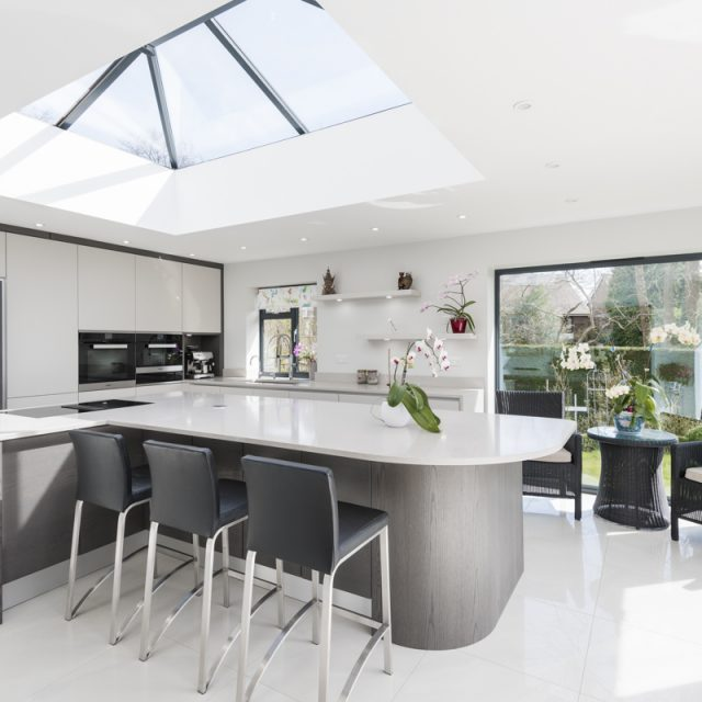 A recent kitchen project by Stoneham. A white kitchen with a bespoke curved island.