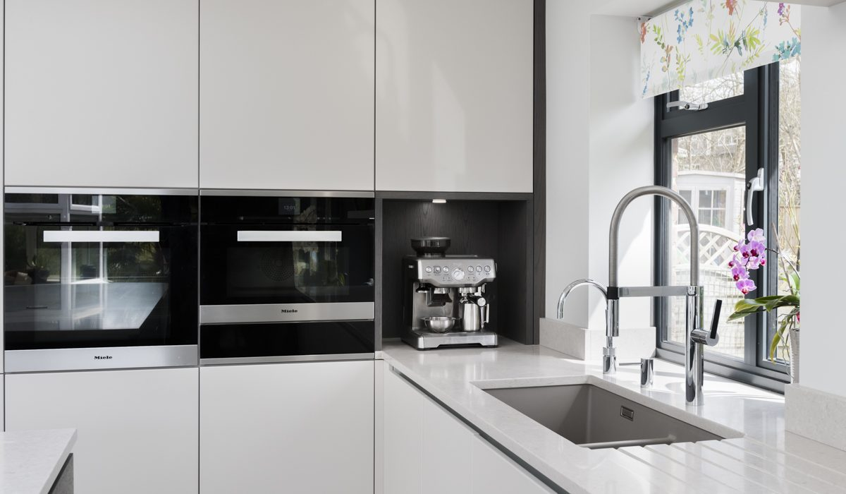 This white kitchen project by Stoneham includes the very latest appliances from Miele.