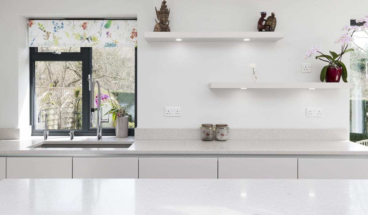 This new Stoneham project includes a white kitchen, with charming floating shelves and integrated Sensio LED lighting.