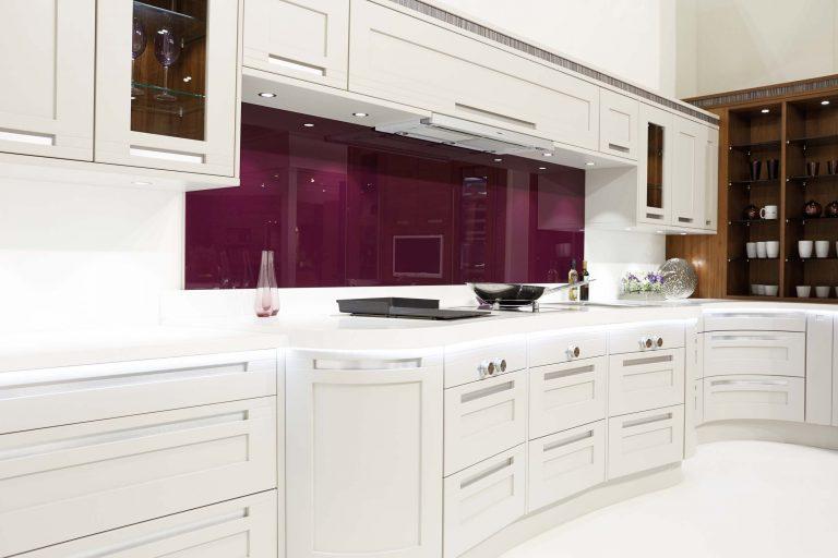 Darwin traditional kitchen in cashmere white with purple glass splashback