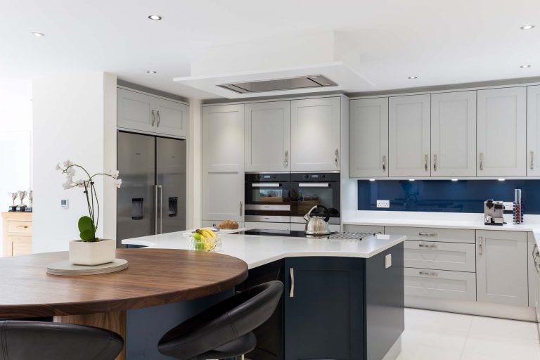 Edwardian Kitchen fridge, oven, white worktops and grey cupboards