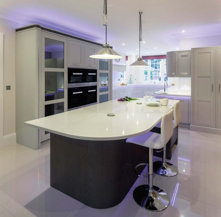 Ightham Kitchen white worktop island and hanging lights