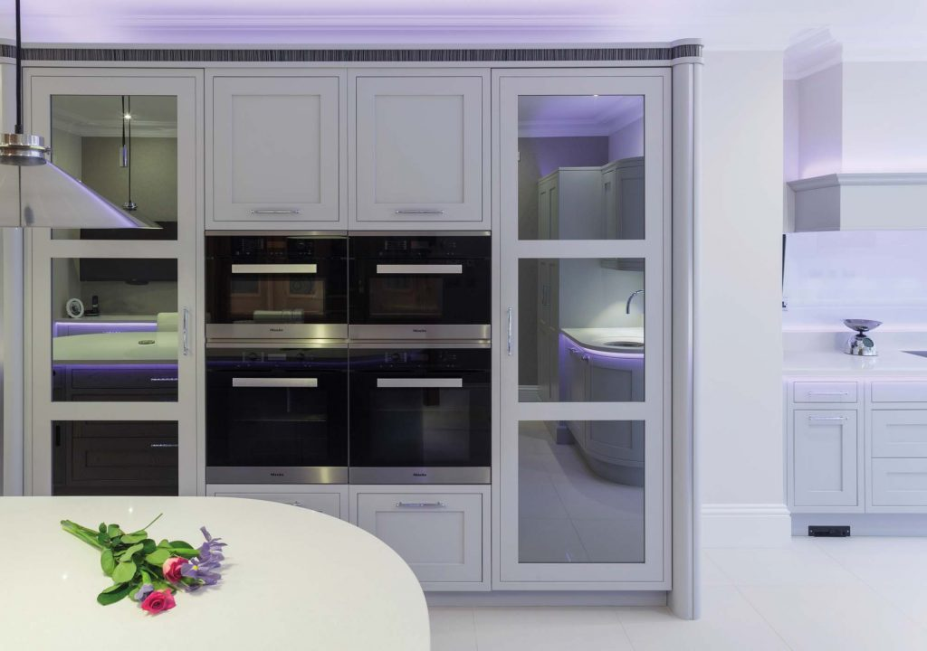 Ightham Kitchen black mirrored cupboards and ovens