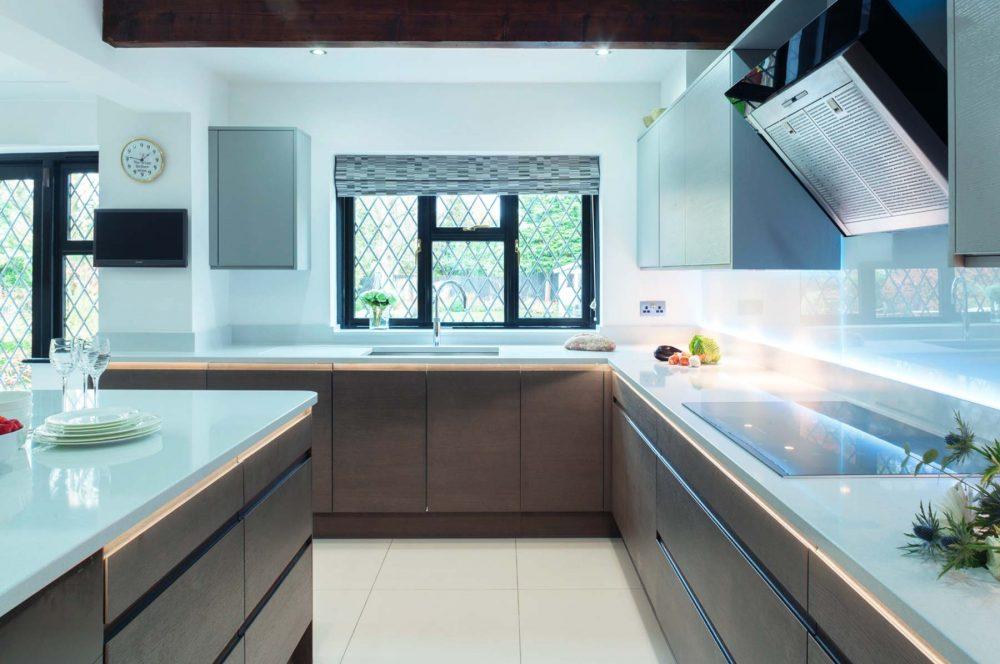 Oak kitchen with white worktops