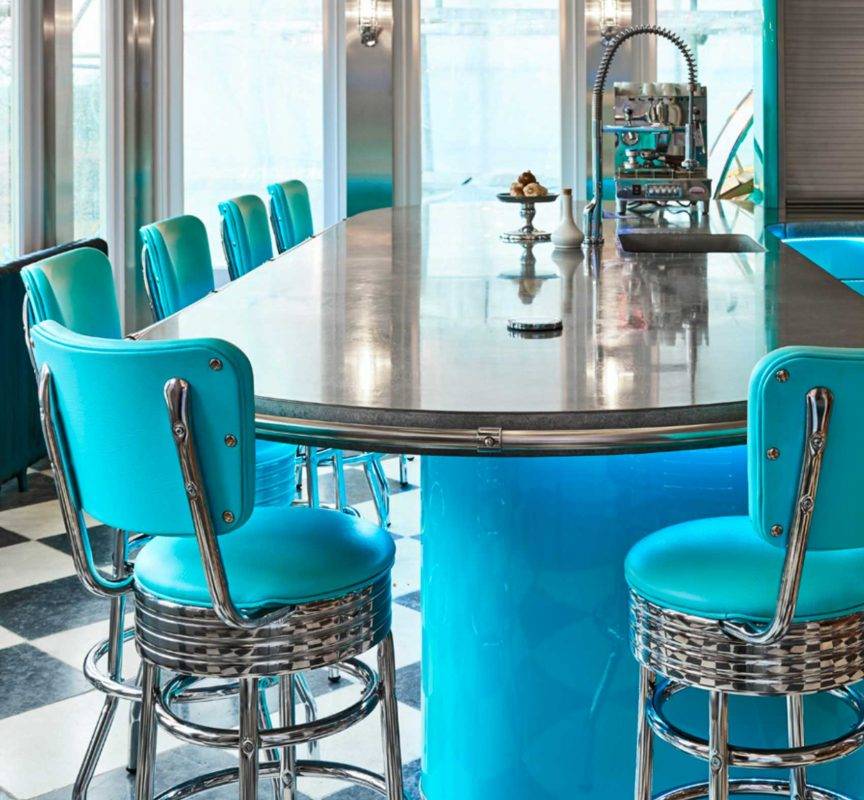 Retro American diner style kitchen with blue bar stools