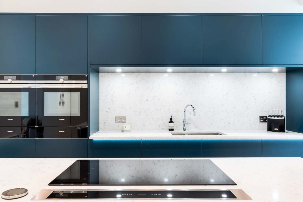 Contemporary Fusion kitchen showing cabinets in blue and induction cooker