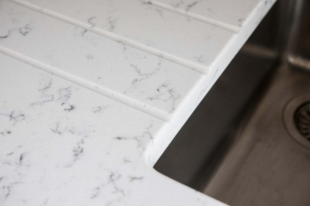Contemporary Fusion kitchen close up of white marble worktop