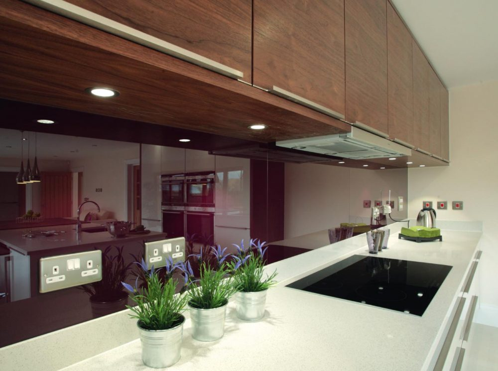 Gloss and wood fusion contemporary kitchen white worktop with purple splashback