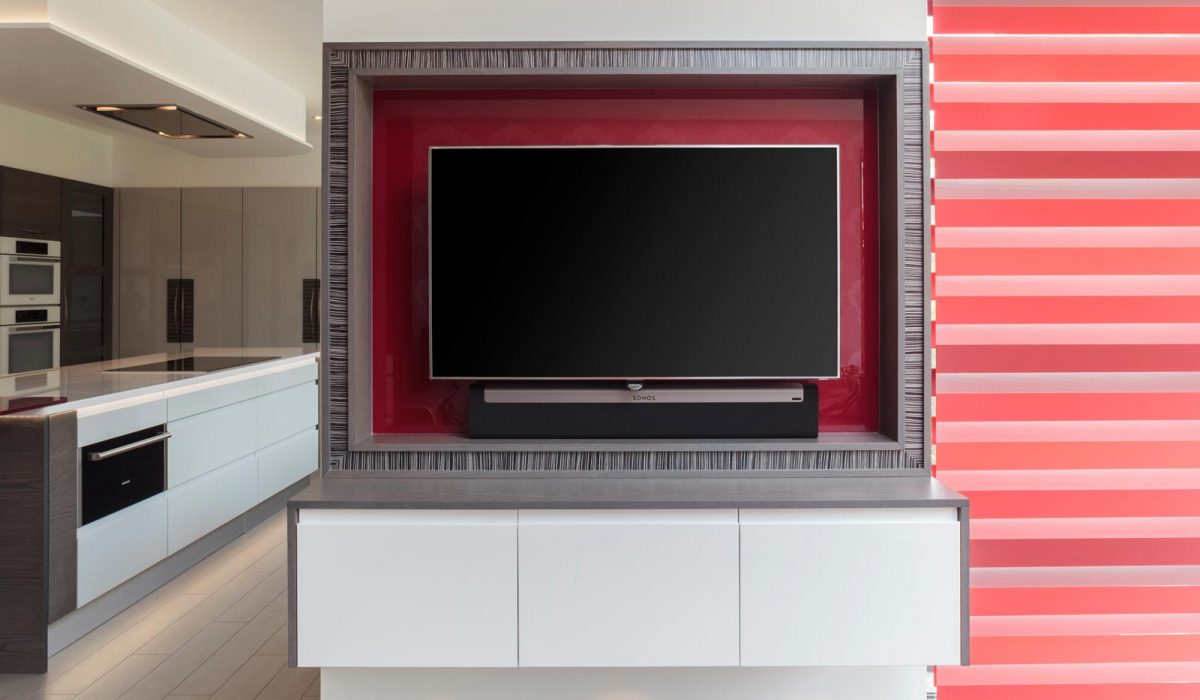 Gloss and wood kitchen with TV surround