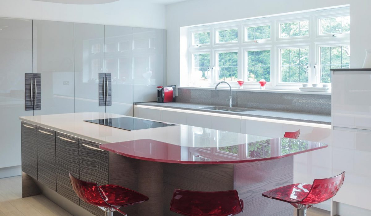 Gloss and wood kitchen with red breakfast bar