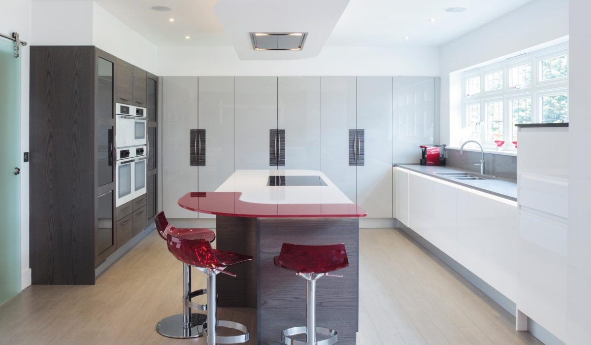 Gloss and wood kitchen with red breakfast bar and bar stools