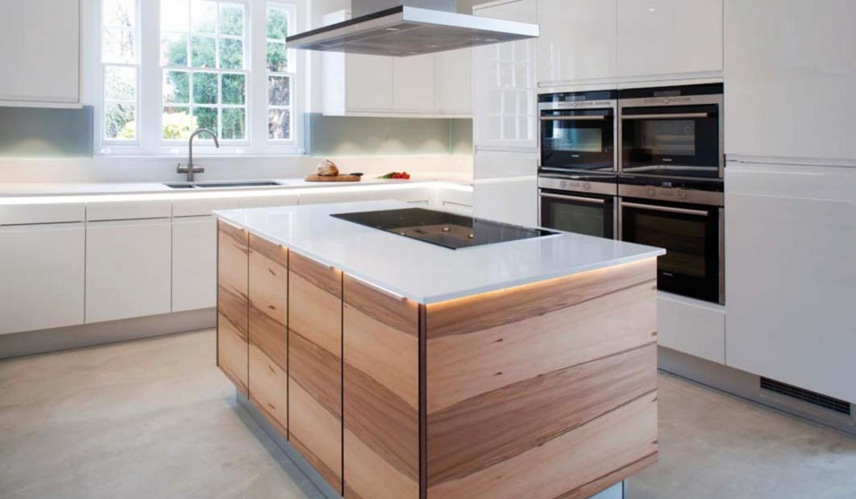 Gloss contemporary kitchen with walnut centre island