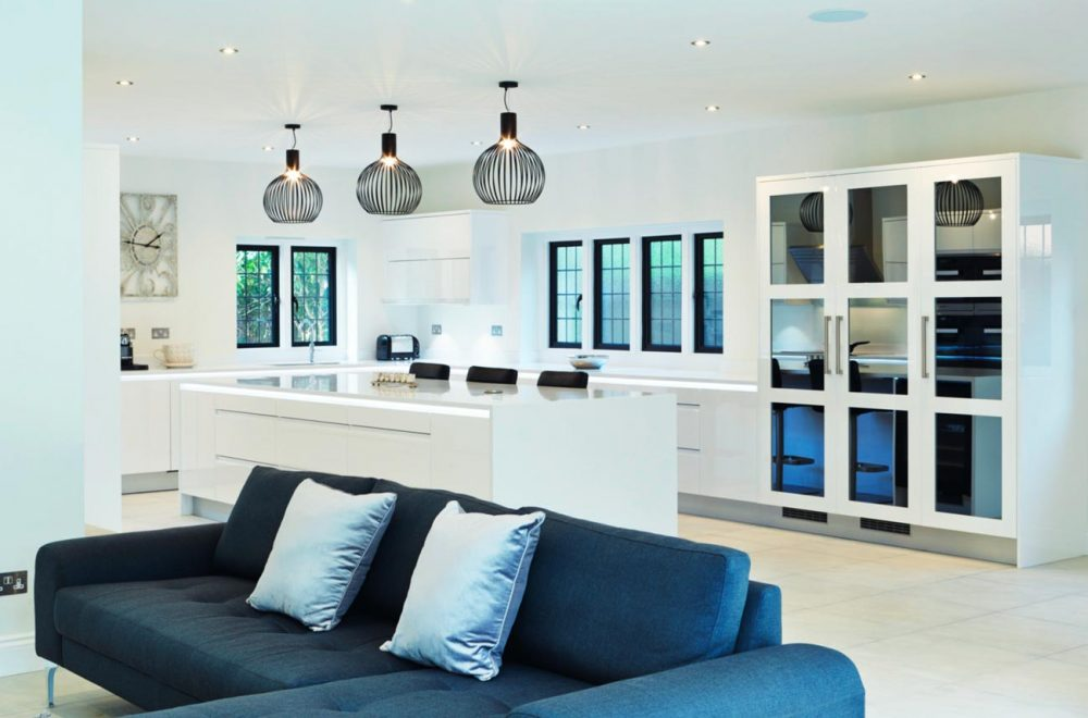 High gloss white kitchen with black metal pendant lights