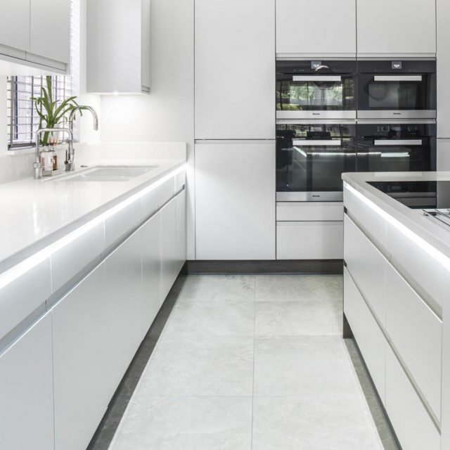 White modern handleless kitchen with sleek lines