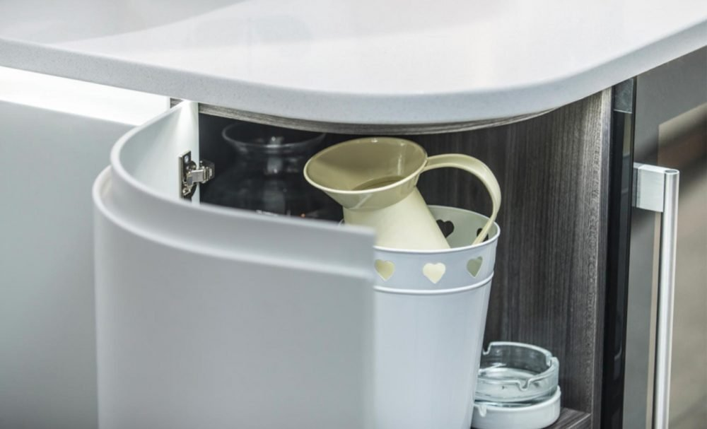 White modern handleless kitchen with intelligent storage solutions