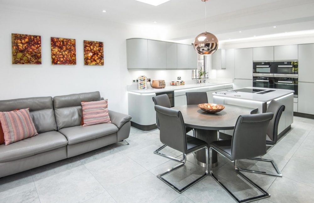 White modern handleless kitchen with open plan living area