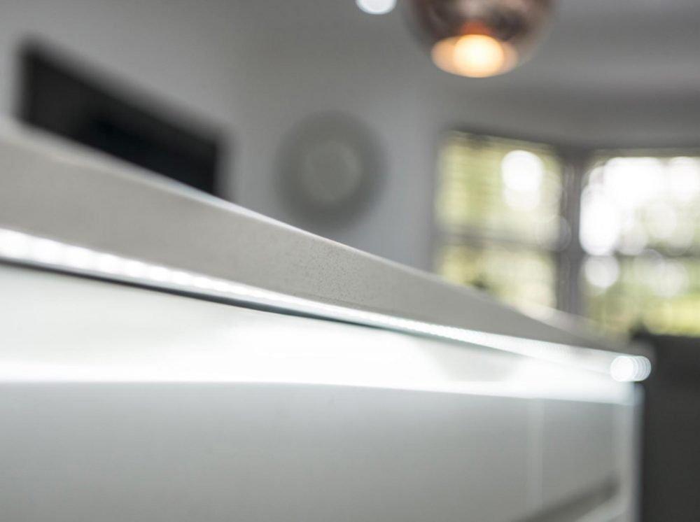 White modern handleless kitchen closeup of lighting