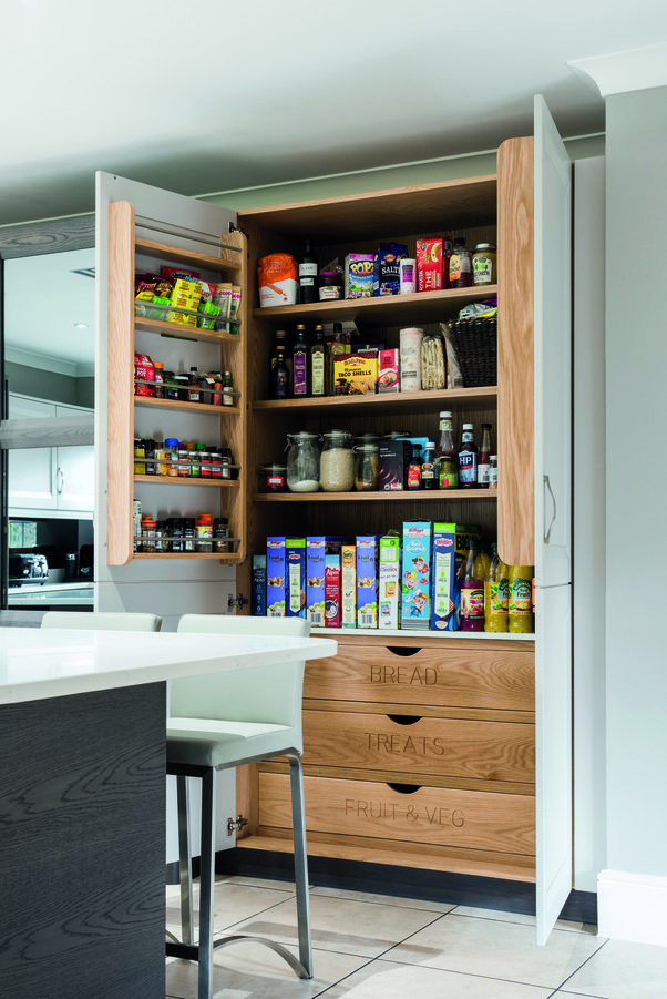 wooden tall kitchen pantry open with door spice rack