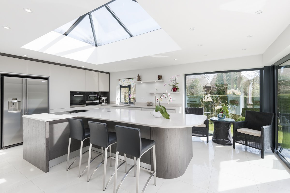 white kitchen with curved island