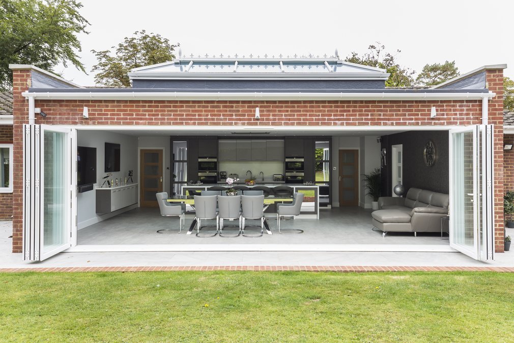 View from garden into kitchen with fully open bi-fold doors