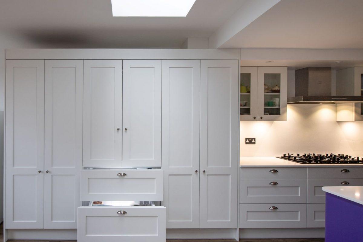White shaker kitchen with chrome handles