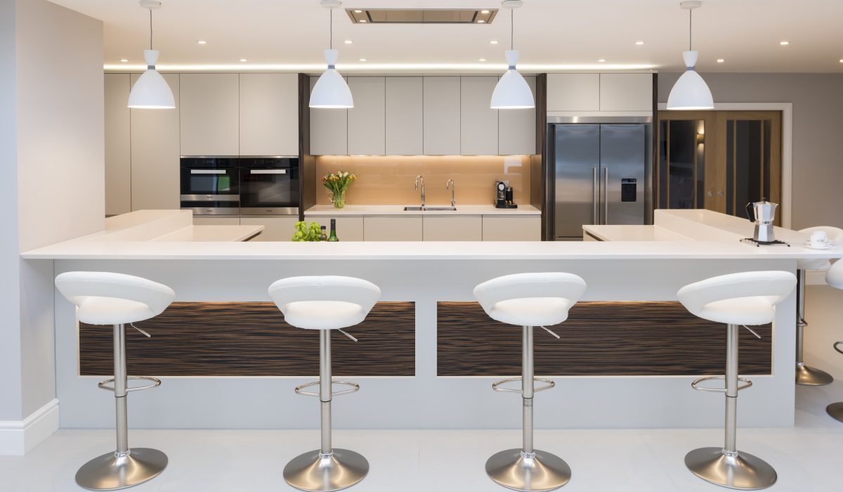 A beautiful kitchen in Ightam, with wonderful timber and dove grey detailing and focal u-shaped island