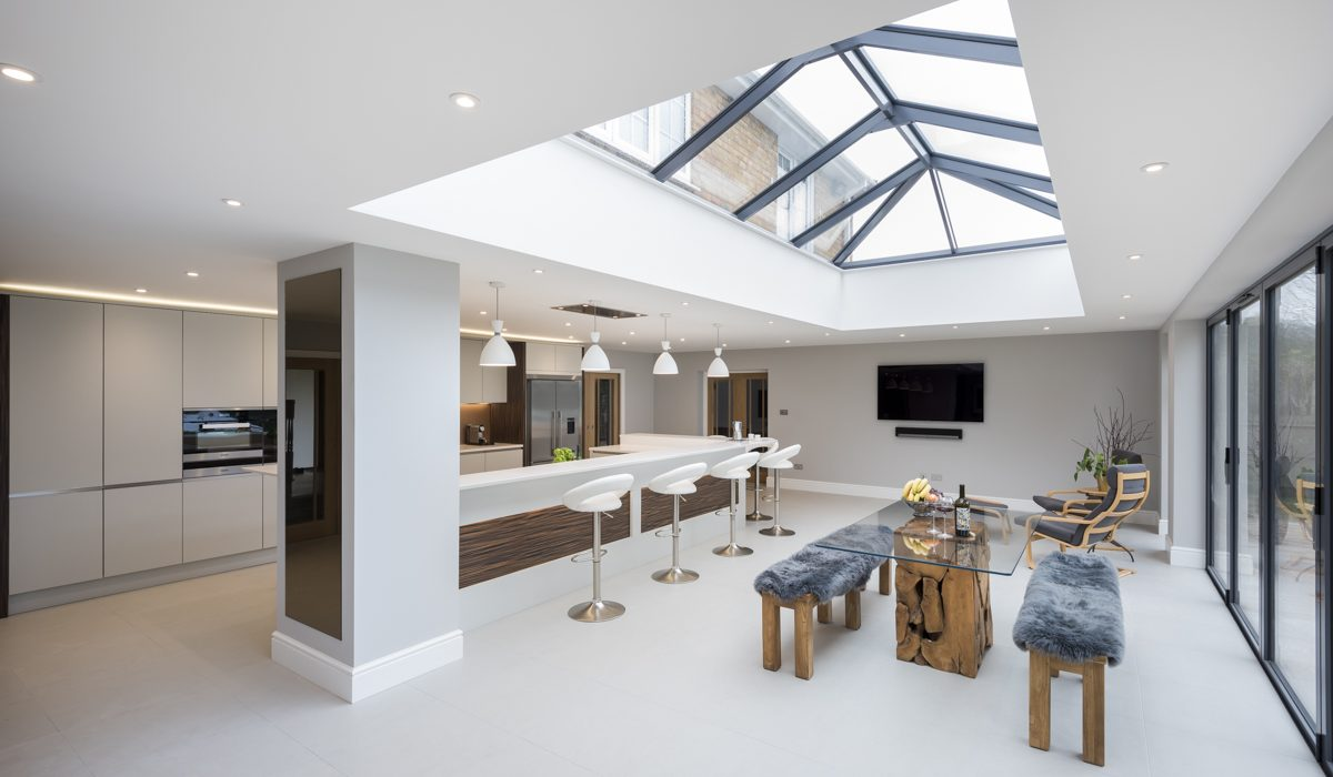 A beautiful kitchen in Ightam, with wonderful timber and dove grey detailing and stunning glazed ceiling