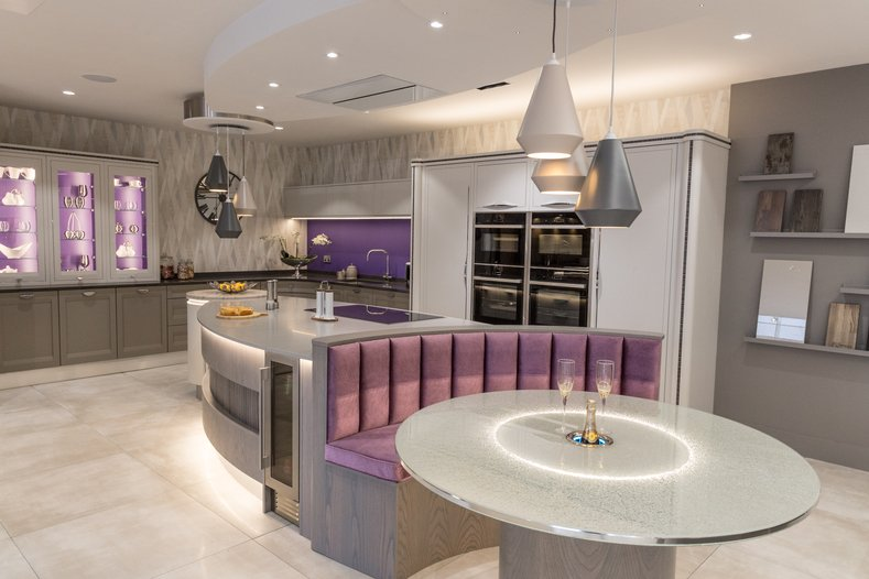 Kitchen island with lilac purple booth and circular table