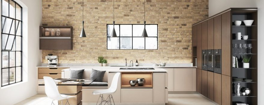 Cream and bronze handleless kitchen design with exposed brick wall and island