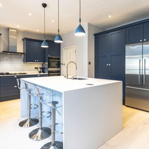 blue shake kitchen with white kitchen island
