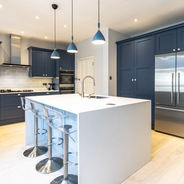 blue shake kitchen with white kitchen island