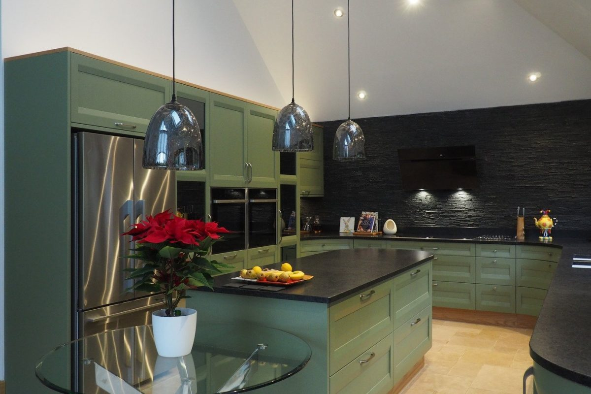 sage green kitchen with curved island