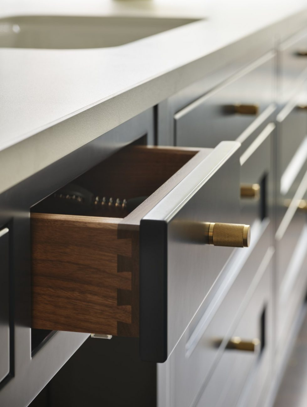 Brass handle on blue kitchen drawer