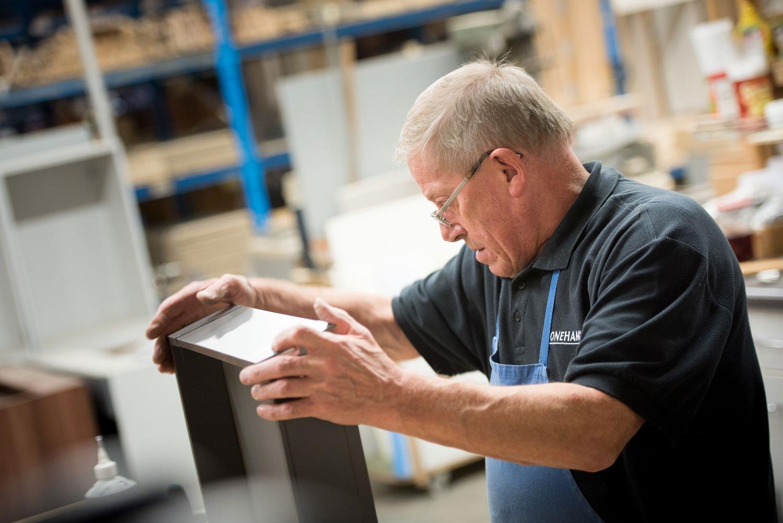 Man assembling drawer for British Kitchens manufacturer Stoneham Kitchens