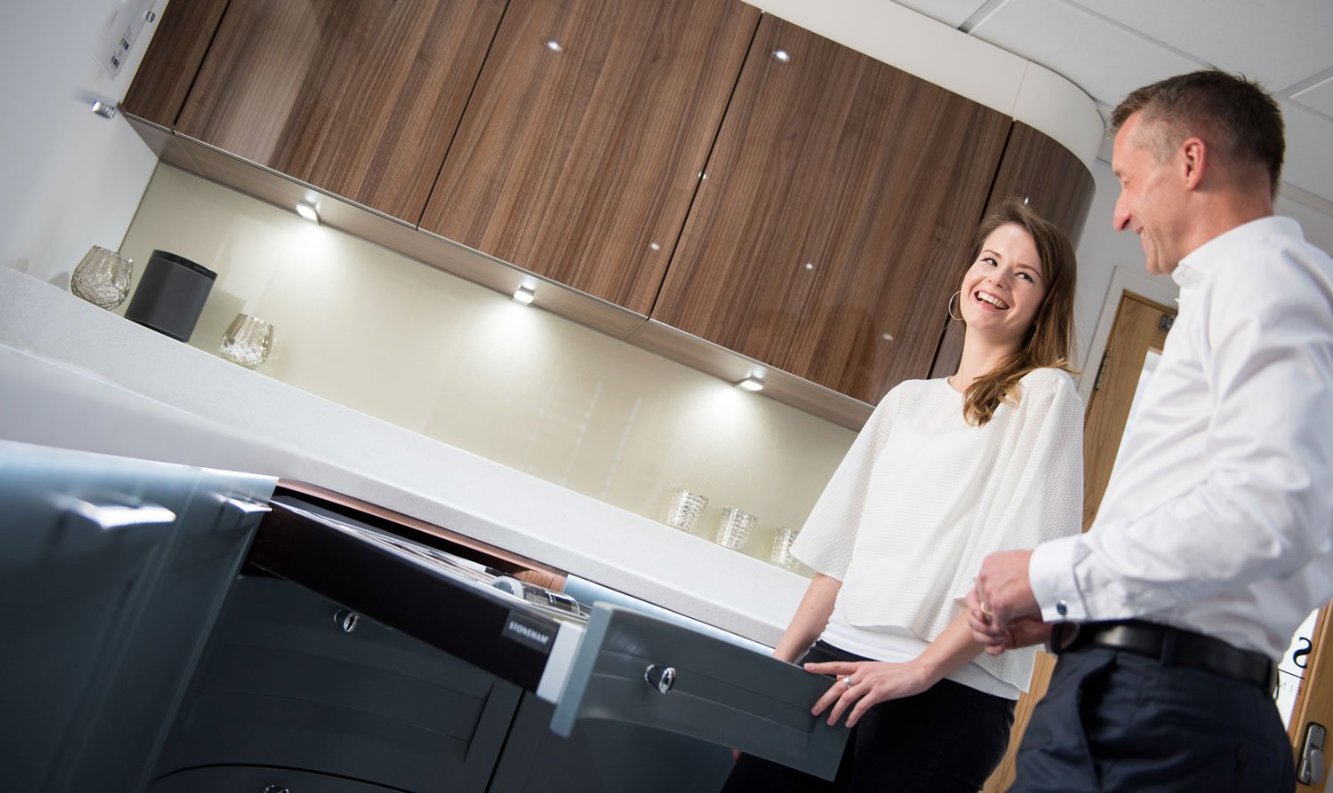 lady and man looking at a kitchen at Stoneham Kitchens showroom