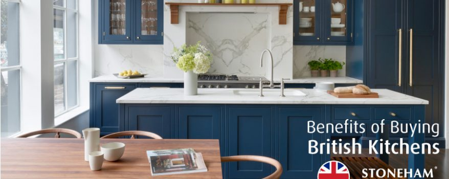 Dark blue kitchen island and cabinets with separate wooden dining table