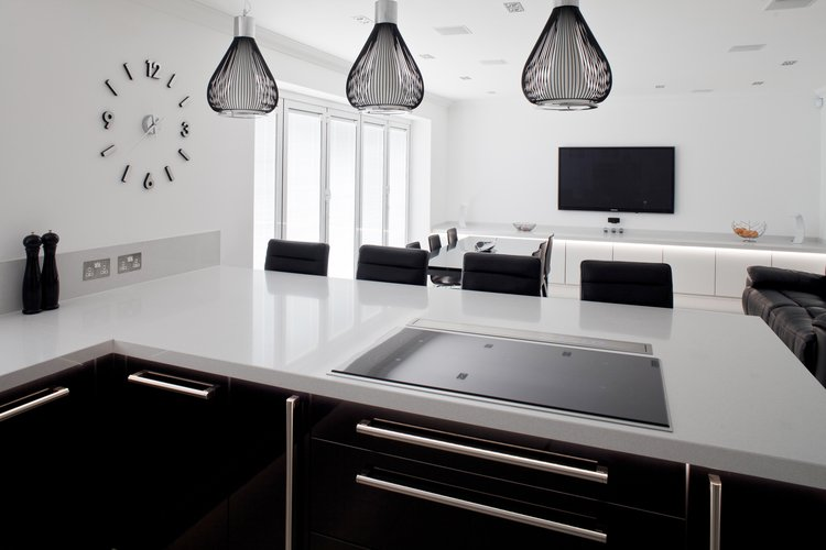 Black and white kitchen with black stalls and black pendant lighting