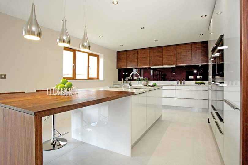 Timber and gloss kitchen in Stoneham Ambience collection