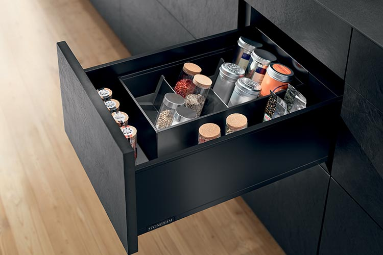 Black kitchen drawer with storage dividers