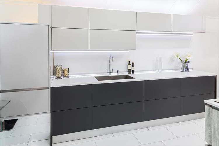 Stoneham Autographic kitchen with black and white units