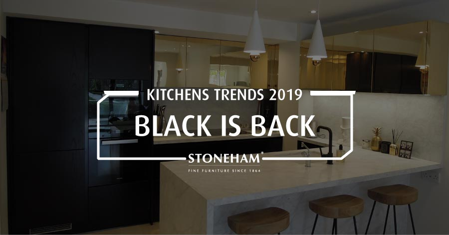Black kitchen with gold cupboards