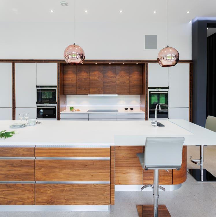 Wooden kitchen with island and copper lighting