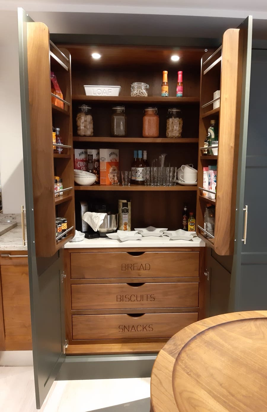 Wooden oak tall pantry cupboard with bespoke engraved drawers