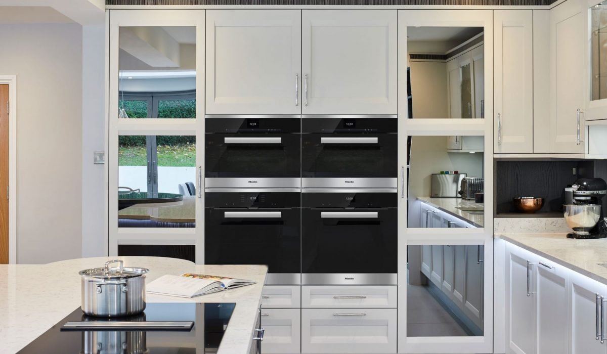 Mirrored tall kitchen cupboards with double ovens