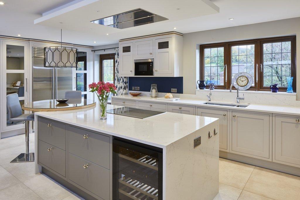 Classic White Kitchen With Circular Oak Breakfast Bar